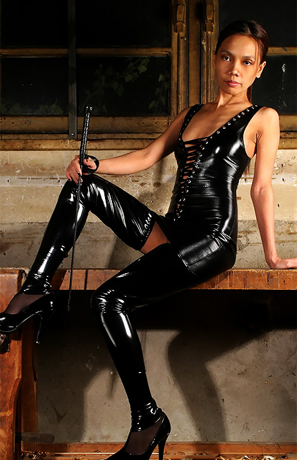 I don't know the name of this beautiful sexy exotic domme from NakedBy but ...